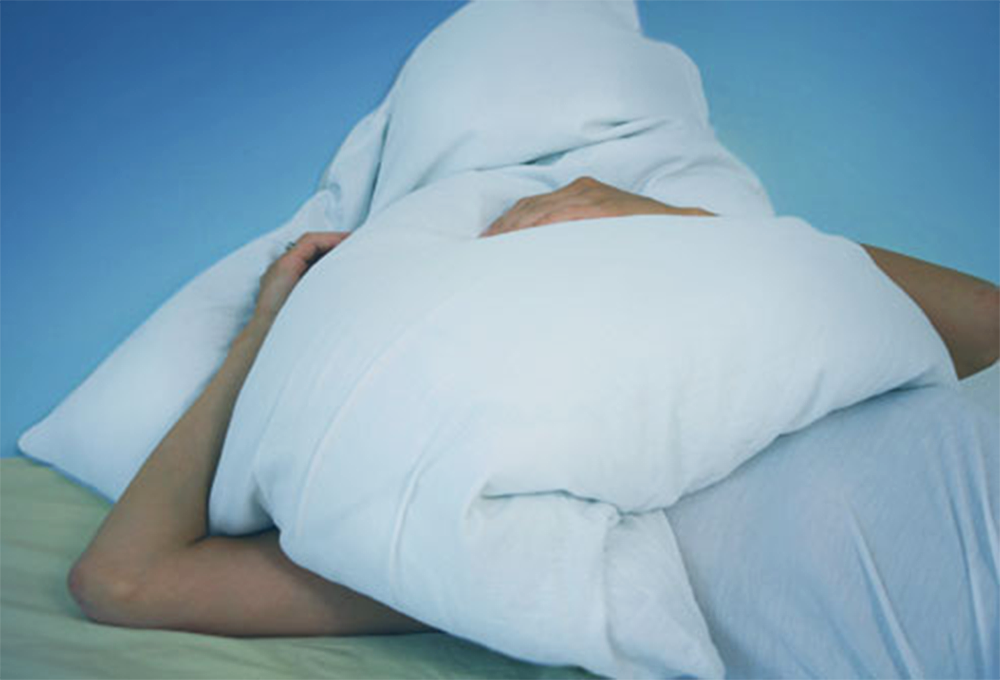 Putting a Pillow to cover head