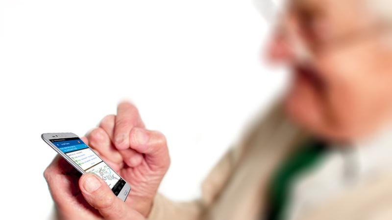 Elderly passenger using mobile
